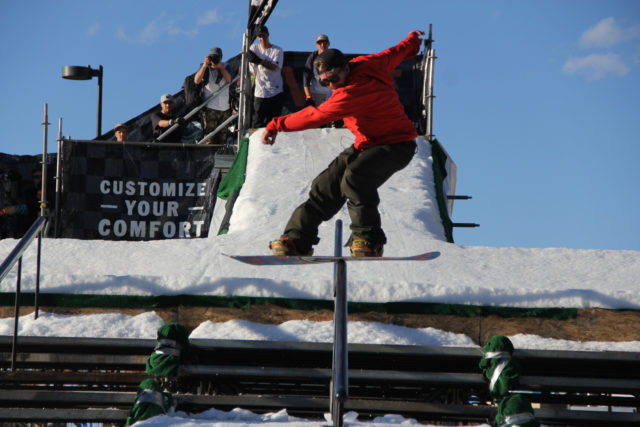 Dylan Alito snowboard on the block rail jam