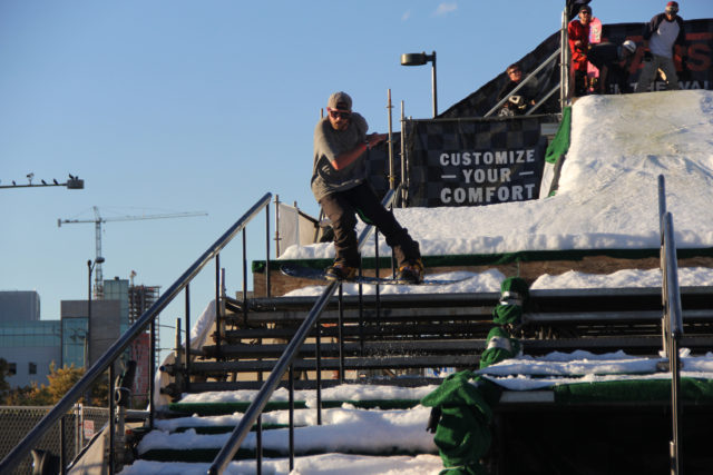 Alex Martin snowboard on the block rail jam.